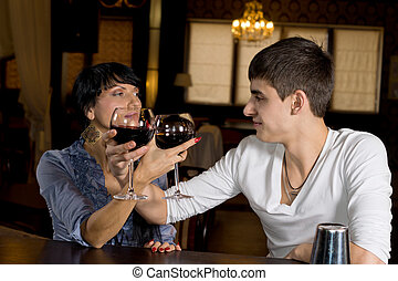 Romantic young couple toasting with red wine