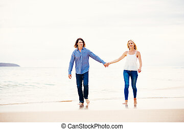Romantic Young Couple Walking on the Beach