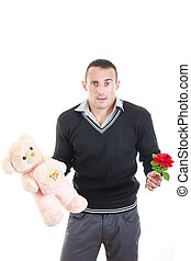 Romantic young man with gifts for valentines day