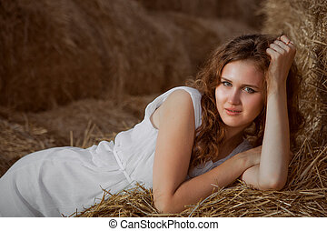 Romantic young woman posing outdoor.