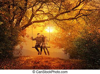 romantisch paar, schommel, in, de, herfst, park