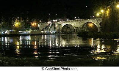 Rome bridge Tiber river night view.
