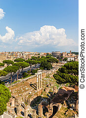 Rome cityscape with view of ruins and colosseum near Altare ...