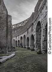 A view of the impressive ancient roman colosseum situated in the Italien capital of Rome.