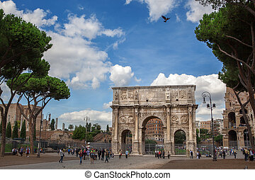 Rome, Italy - 17 october 2012: Tourists walking near Constantine's arc in Rome - triumphal arch in Rome, situated between the Colosseum and the Palatine Hill