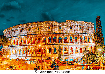 ROME, ITALY-MAY 07, 2017:  Beautiful landscape of the Colosseum in Rome through street Via degli Annibaldi with cars in the night time.