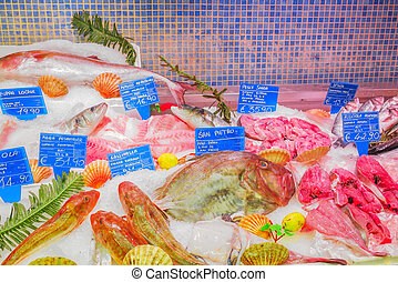 ROME, ITALY, MAY 10, 2017 : Shop, spermarket, counter with dry forehead and seafood on it (fish, shrimp, langoustines, crabs, squid, seashells, mussels, oysters). Italy.