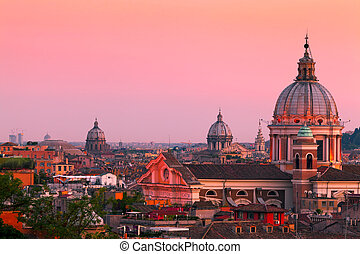 Rome, Italy - Rome skyline at dusk. In the foreground San...
