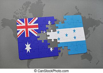 rompecabezas, con, el, bandera nacional, de, australia, y, honduras, en, un, mapa del mundo, fondo.