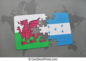 rompecabezas, con, el, bandera nacional, de, gales, y, honduras, en, un, mapa del mundo