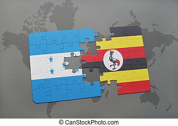 rompecabezas, con, el, bandera nacional, de, honduras, y, uganda, en, un, mapa del mundo