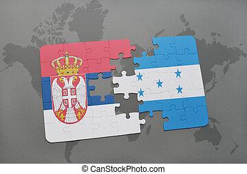 rompecabezas, con, el, bandera nacional, de, serbia, y, honduras, en, un, mapa del mundo