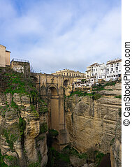 Ronda, Spain - 2 February, 2021: A vertical view of the old town of Ronda and the Puente Nuevo over El Tajo Gorge