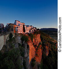 Magnificent view from the New Bridge of Ronda in Andalusia, Spain at evening