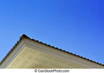 Roof and clear blue sky