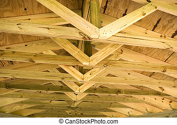 Roof and Trusses - Fresh new pine roof and trusses in an...