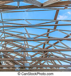 Roof beams of a new wooden construction looking up
