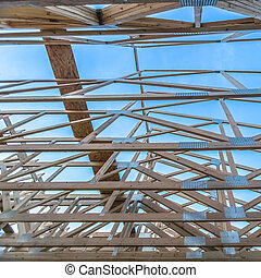 Roof beams of a new wooden construction square