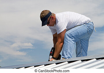 Roof Construction Worker - Construction worker uses a power...