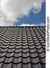 Roof from a metal tile. - Roof from a metal tile on a...