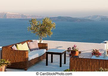 Roof garden cafe restaurant at Santorini island in the Aegean sea in Greece