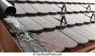 Roof in the rain. - Rain drops falling down on the roof with...