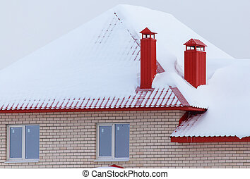 Roof of a country house in the snow in winter