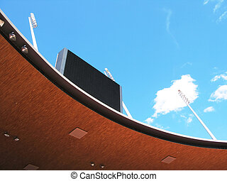 Roof of a stadium and scoreboard