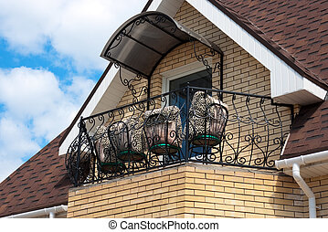 Chairs and pillows on a balcony of the beautiful house