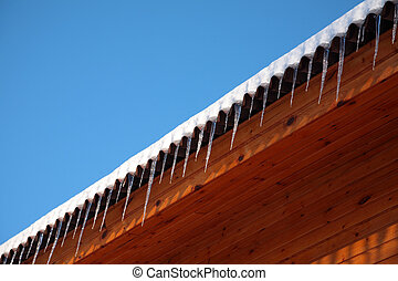 Roof of house with icicles