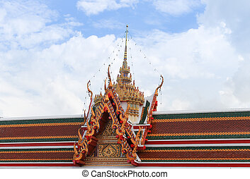 Roof of temple on blue sky background