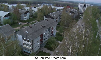 Roof of town apartment building aerial video - Roof of town...