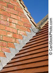 Roof repair lead flashing and new clay tiles