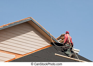 Roof Repairs - Roof repairs of an apartment building in...