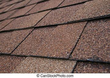 closeup detail of brown roof shingles