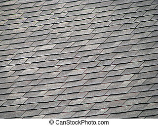 Roof Shingles - background of gray rectangular shingles on...