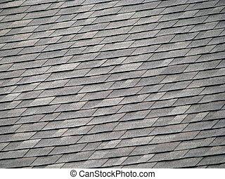 Roof Shingles - background of gray rectangular shingles on...