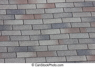 Roof Shingles - A close up view of shingles on a roof