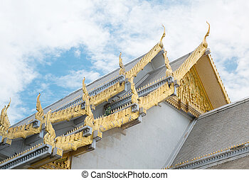 roof style of thai temple with gable apex on the top and blue sky