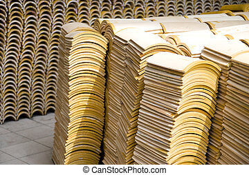 Roof Tiles - Image of stacks of roof tiles.