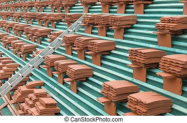 Roof tiles stacked on a roof close up, UK