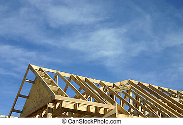 Roof top - roof frame against a blue sky