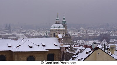 Roof tops of Prague in Winter. Snowy day