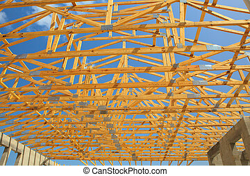 Roof Truss, Construction - Roof trusses sitting a cement...