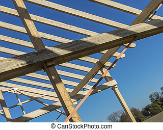 roof truss of a new roof - on a house, a new roof is being...