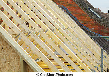 Roof trusses detail - Detail of new timber roof trusses on a...