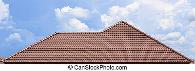 roof under construction with stacks of roof tiles for home ...