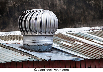 Roof Ventilator on a  old rusty roof