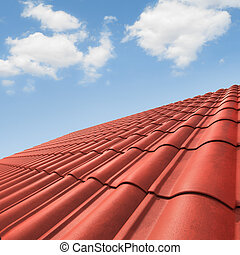 Roof - View of red roof tiles and cloudy sky on the ...