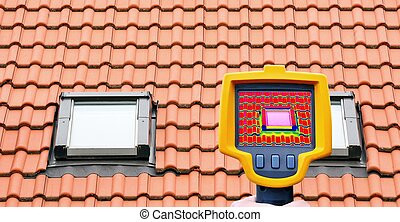 Roof window heat loss - An infrared thermal imager showing...